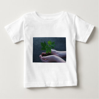 A sprout on a hand baby T-Shirt