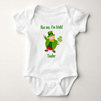 A St. Patrick's Day leprechaun holding a shamrock, Baby Bodysuit