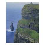a stone castle standing on top a steep cliff in poster