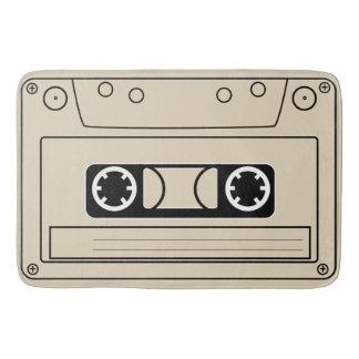 A stylised cassette tape. bath mat