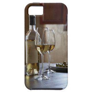 A table with bottle and two glasses of Spanish iPhone 5 Case
