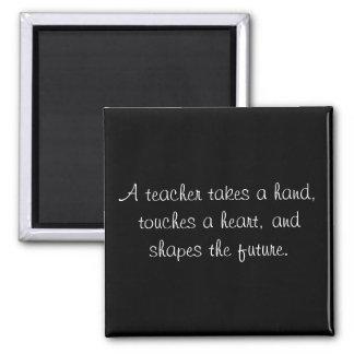A teacher takes a hand, touches a heart, and sh... magnet