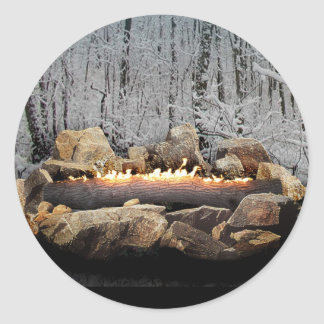 A Tranquil Burning Yule Log in a Snowy Forest Classic Round Sticker