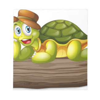 A turtle above a log notepad