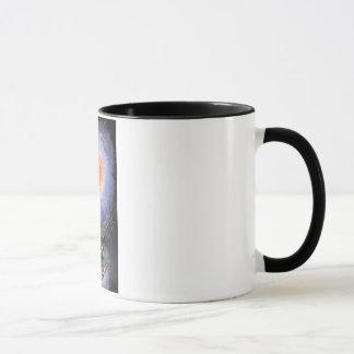 A turtle wondering in galaxy mug