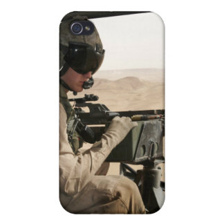 A UH-1N Huey crew chief scans the ground Covers For iPhone 4