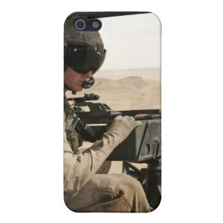 A UH-1N Huey crew chief scans the ground iPhone 5 Covers