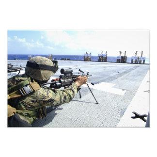 A US Marine adjusting his weapon Photo