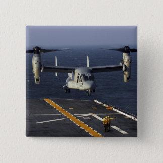 A V-22 Osprey aircraft prepares to land 2 Inch Square Button