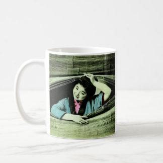 A Vintage Japanese Geisha Peeking Through a Blind Coffee Mug