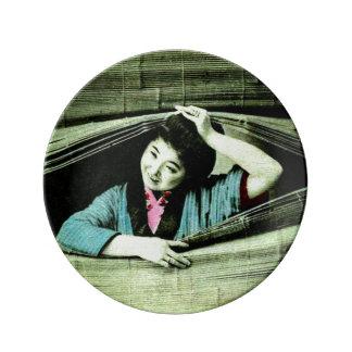 A Vintage Japanese Geisha Peeking Through a Blind Porcelain Plate