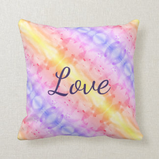 A Watercolor Art Pillow With Pinks