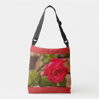 a wetted rose on All -over-Print Cross Body Bag