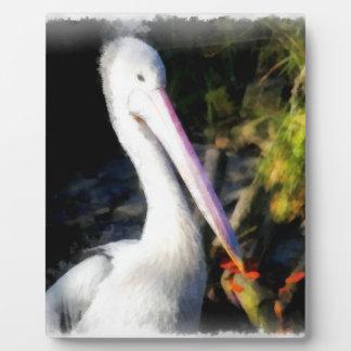 A white bird and its big beak plaque