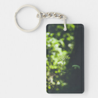 A wild flower in the green nature keychain
