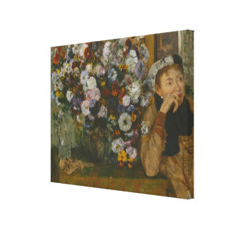 A Woman Seated beside a Vase of Flowers Canvas Print