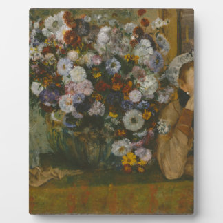 A Woman Seated beside a Vase of Flowers Plaque
