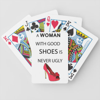 a woman with good shoes bicycle playing cards