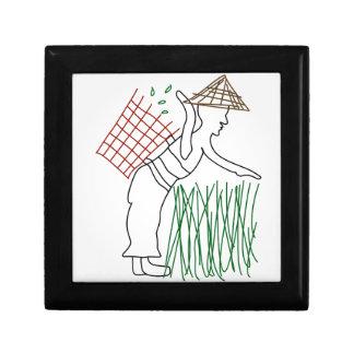 A worker harvesting tea leaves gift box