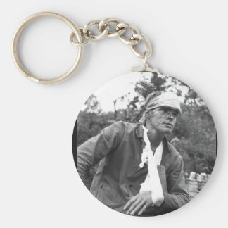 A wounded U.S. Marine awaiting_War Image Basic Round Button Keychain