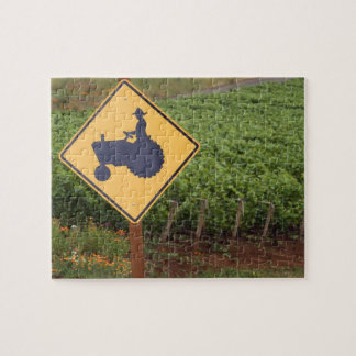 A yellow tractor crossing sign in the vineyard jigsaw puzzle