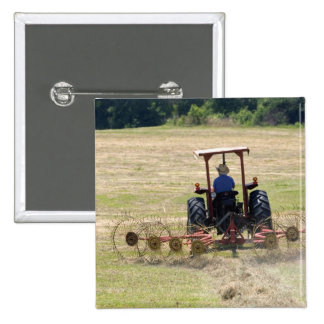 A young boy driving a tractor harvesting 2 inch square button