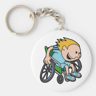 A young boy racing in a wheelchair keychain