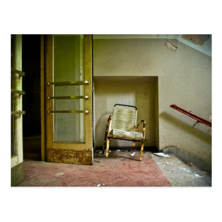 Abandoned Building with Empty Chair Postcard