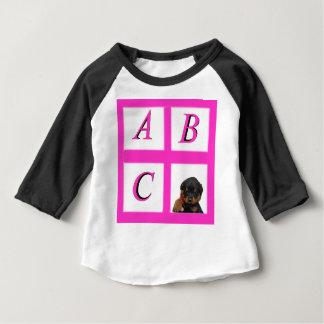 abc window pane rottweiler baby T-Shirt