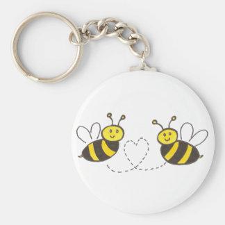 Abeilles de miel avec le coeur porte-clé rond