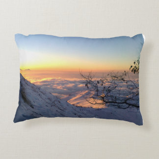 Above clouds in the snowy mountain accent pillow