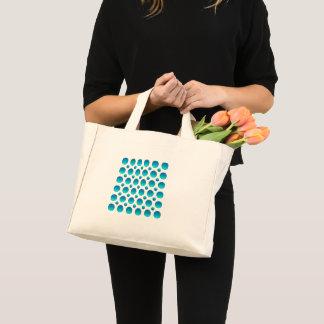 Abstract blue polka dots. mini tote bag