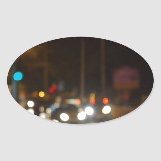 Abstract colored lights from moving vehicles oval sticker