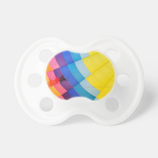 Abstract colorful baby pacifiers