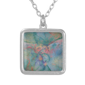 Abstract design with soft colors of peach and blue silver plated necklace
