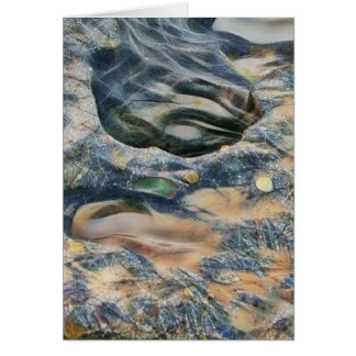 Abstract eroded rocks on beach greeting card