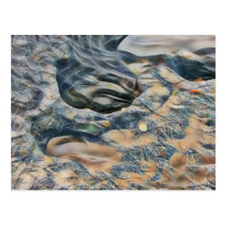 Abstract eroded rocks on beach greeting card postcard