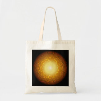 Abstract glow golden circle on black background tote bag