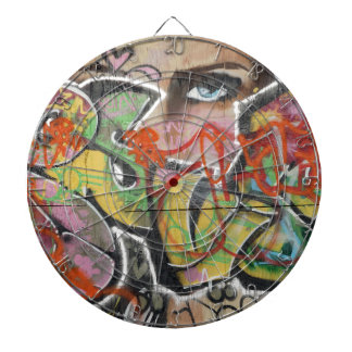 abstract graffiti art mural text type womans face dartboard