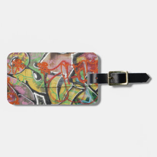 abstract graffiti art mural text type womans face luggage tag