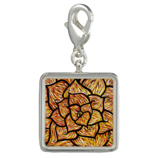 Abstract Orange Flower Charm