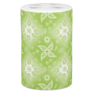 abstract paisley green pattern. soap dispenser and toothbrush holder