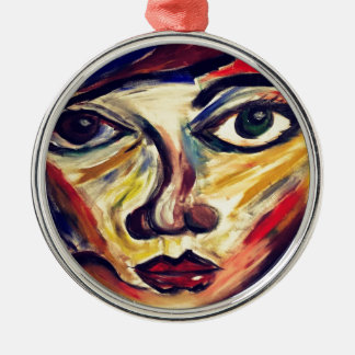 Abstract woman's face metal ornament