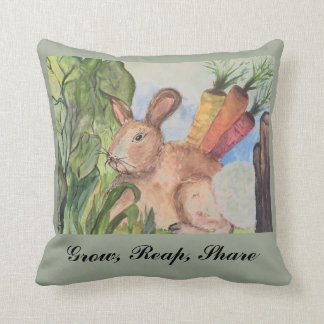 Accent pillow with rabbit in garden.