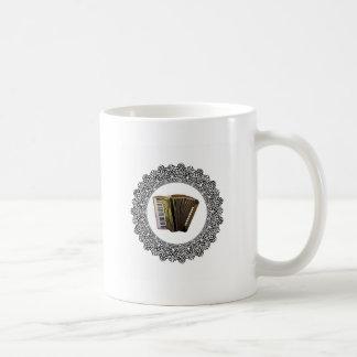 accordion in a round coffee mug