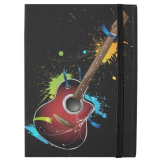 Acoustic guitar with paint splatters