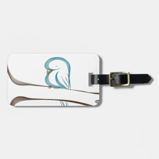 Adorable blue bird sitting on a branch luggage tag
