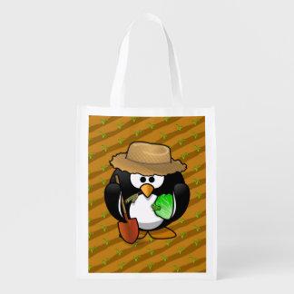 Adorable Cartoon Penguin Farmer on Field Market Totes