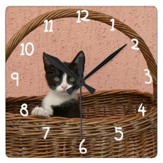 Adorable kitten in basket clock