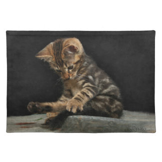 Adorable kitten playing with tail placemat